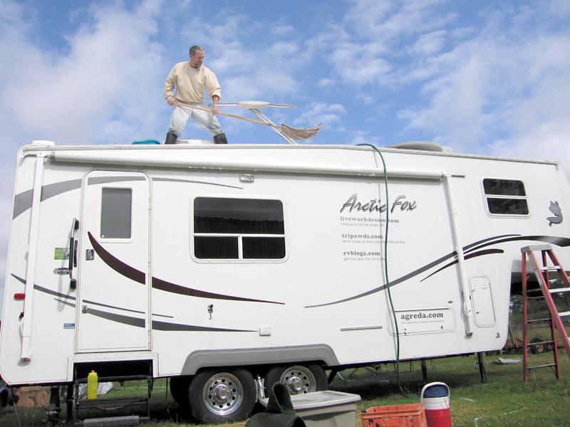 Jim Swabs the RV Top Deck