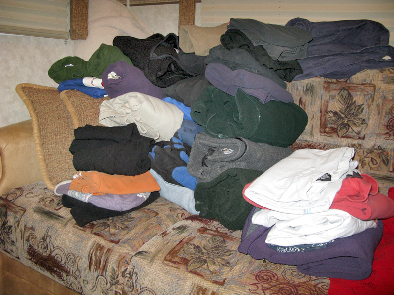 pile of free clothes after silverton yard sale