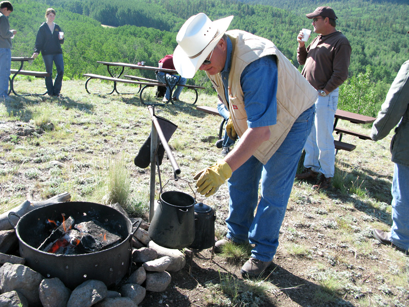 Larry Vickers makes cowboy coffee on breakfast ride