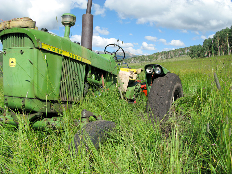 John Deere Tractor stuck in wet hay field