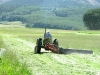 Larry Vickers mowing hay field in Lake City, CO