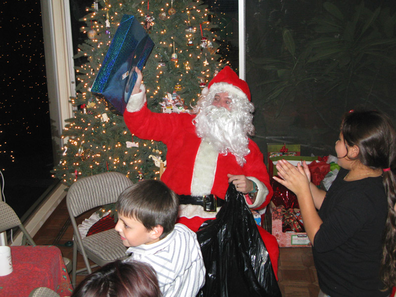 Good Santa Jim gives out gifts Christas Eve