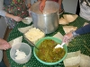 making homemade green chili and cheese tamales