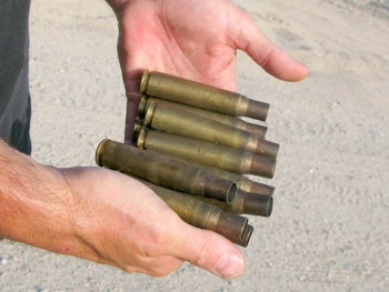Collecting 50 cal. Brass Ammunition Rounds Slab City