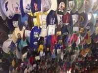 Toad River Lodge Ceiling Hat Collection, on Highway 97 Brittish Columbia