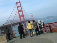 Asian tourists photograph the Golden Gate Bridge