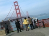 Asian tourists photograph the Golden Gate Bridge