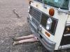 Maxine helps repair 1978 Bluebird Bus