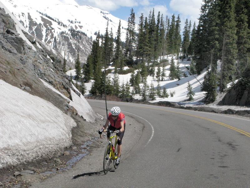 Crazy cyclist on Red Mountain Pass near Ouray Colorado