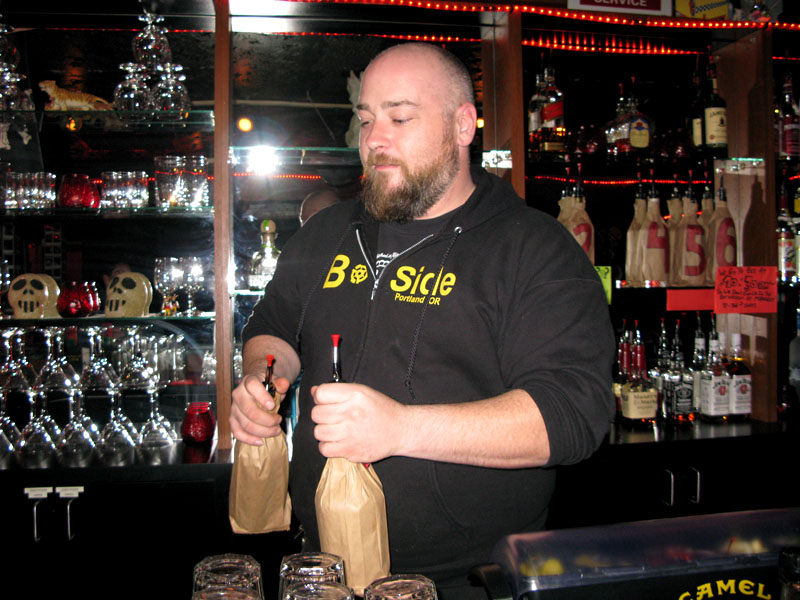 Red Room bartender pours Mystery Shots