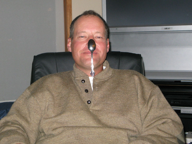 pat hangs spoon on his nose