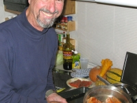 Sam cooks fresh wild Alaskan salmon he caught