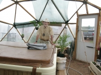 Sand Creek Realtor Duke in off Grid Greenhouse