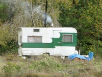 Rogue River Resident Camper with Wood Stove