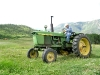Larry Vickers mows hay on old John Deer tractor