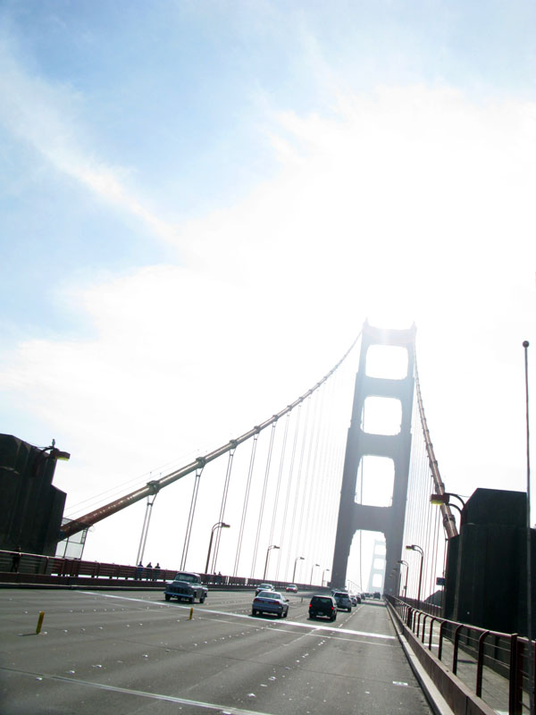 Sun shines through Golden Gate Bridge