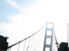 Sun shines through Golden Gate Bridge