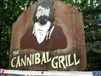 Cannibal Grill sign in Lake City, CO depicts Alfred Packer