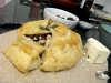 Homemade baked brie in pastry puff with almonds, cranberries and honey by Sonja