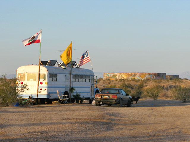 Slab City bus by the tanks