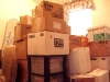 Boxes piled high in new spare room