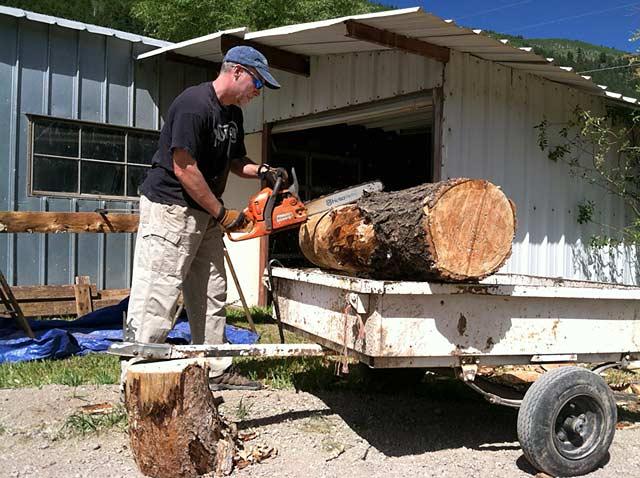 making log benches at ranch workamping job