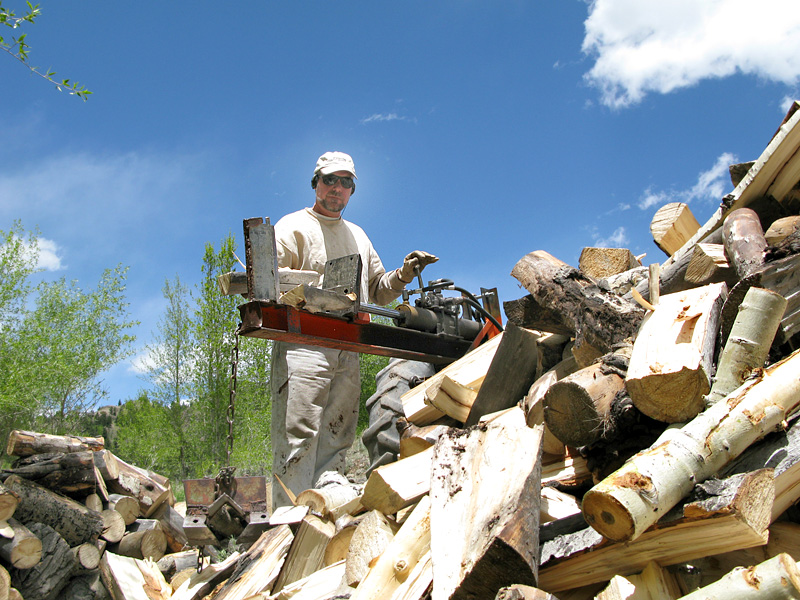 Jim Splitting Logs with Tractor Mounted Splitter