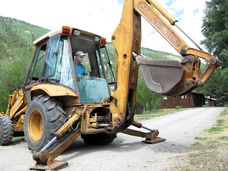 Jim Operates Backhoe to install Street Sign Posts