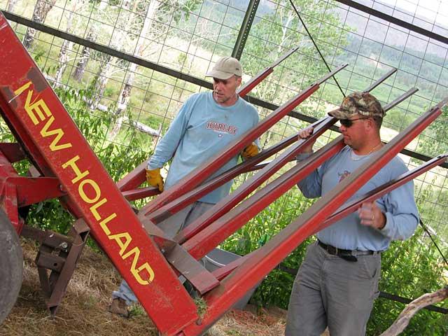 Jim and Paul ponder broken stacker at Vickers Ranch Hay Barn