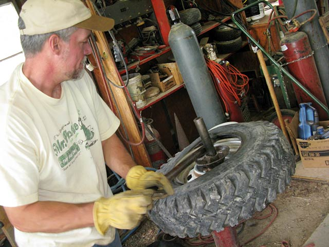 mounting tire in ranch workshop