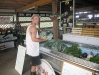 Restocking organic produce at the White Rabbit Acres farm store