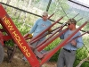 Jim and Paul ponder broken stacker at Vickers Ranch Hay Barn